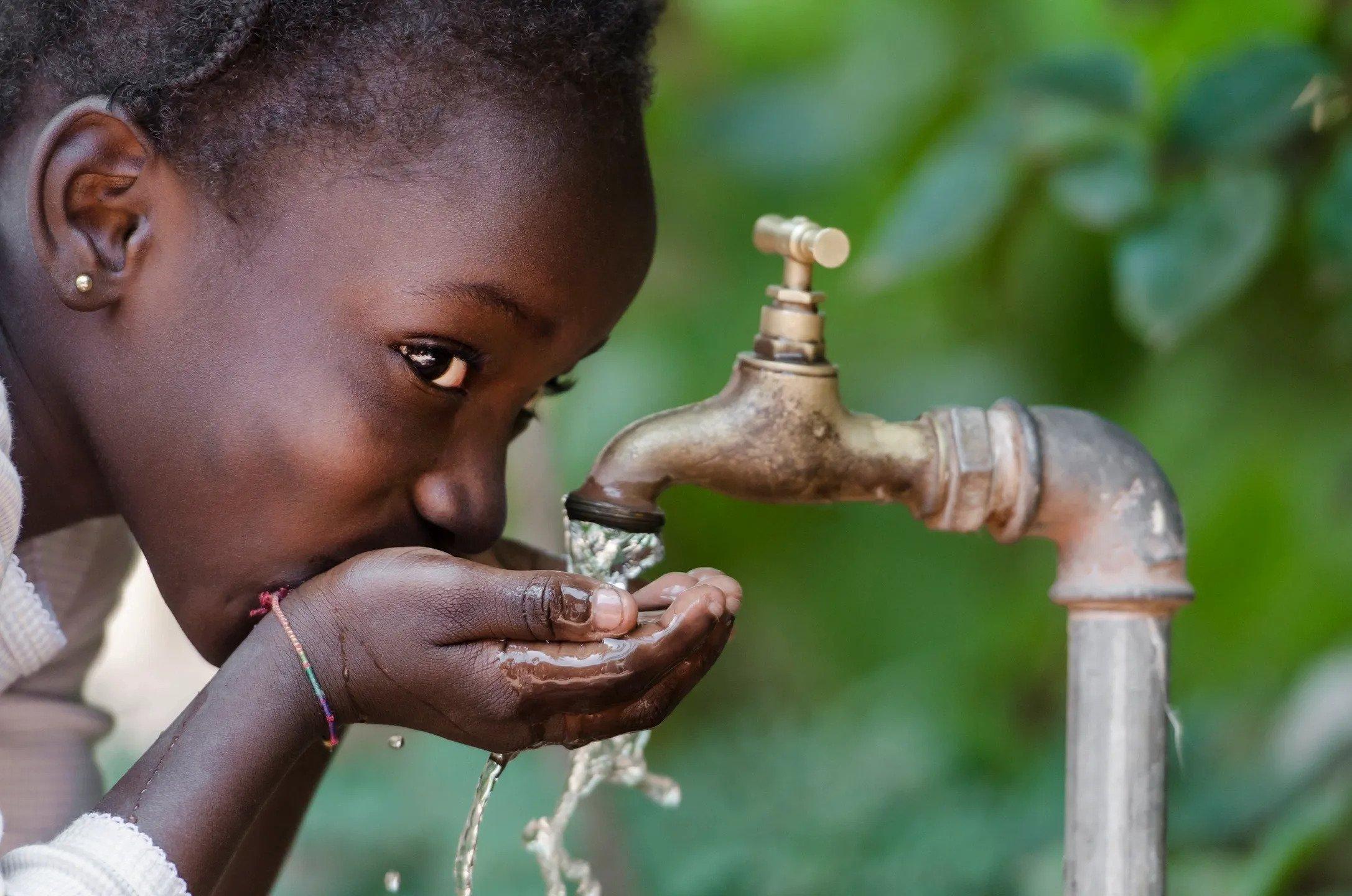 Haiti girl drinking water